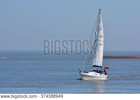 Felixstowe, Suffolk, England - June 26, 2020: Yacht Under Sail At The Estuary Of The River Deben At