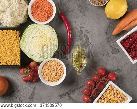 Organic Vegetables, Fruits And Legumes On A Gray Background. The View From The Top.