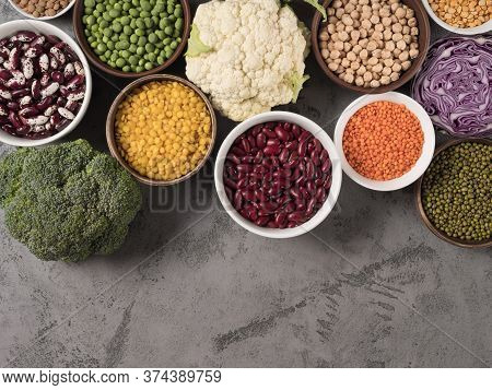 Assorted Fresh Cabbage And Different Legumes On Gray Background.