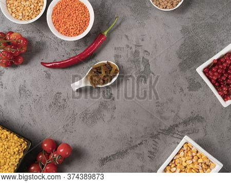 Red And Yellow Grains, Berries And Vegetables For Cooking.