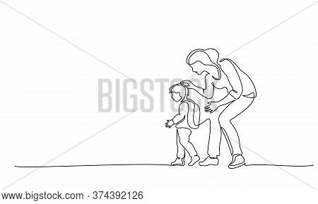 Mother Escorts Her Young Son To First Grade At School