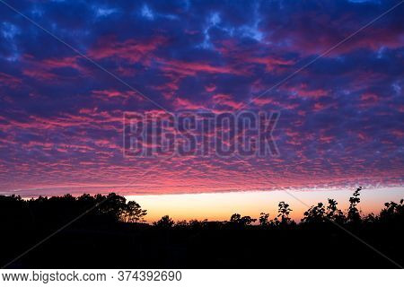 Cloudy Sunset Sky Over A Field And Unusual Altocumulus Clouds With Blue And Violet Colors