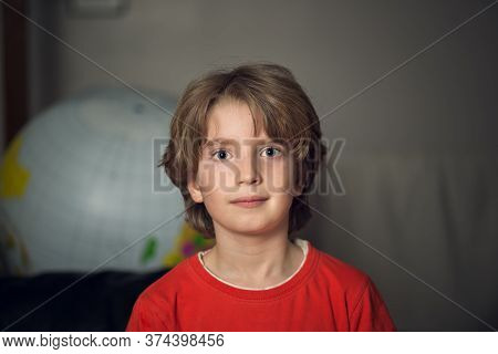 Portrait Of A Boy With A Red Shirt