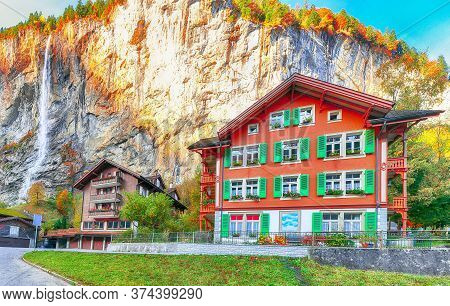 Fantastic Autumn View Of Lauterbrunnen Village With Awesome Waterfall  Staubbach  In The Background.