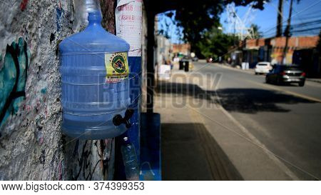 Salvador, Bahia / Brazil - July 1, 2020: Improvised System Of Hand Washing Seen On The Street In The