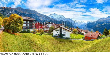 Awesome Autumn View Of Picturesque Alpine Village Wengen.  Sunny Morning Scene Of Swiss Alps. Locati
