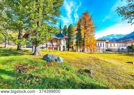 Awesome Autumn Scene In Swiss Alps And Maloja Palace. Colorful Autumn Scene Of Swiss Alps. Location: