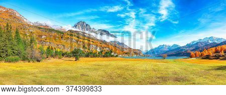 Charming Autumn Scene In Swiss Alps And Views Of Sils Lake (silsersee). Colorful Autumn Scene Of Swi