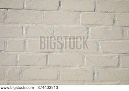 The Background Consists Of A Fragment Of A Brick Wall Exposed By Whitewash.