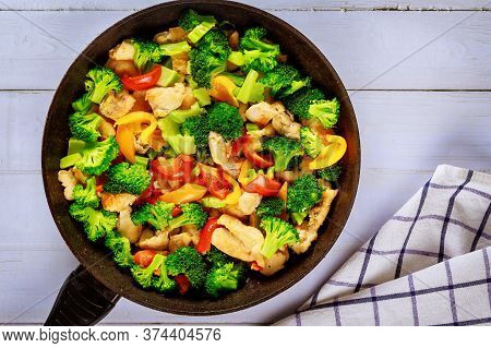 Healthy Stir-fried Chicken, Broccoli And Bell Peppers. Chinese Cuisine.
