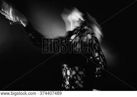 Spiritual Dance. Reincarnation Freedom. Defocused Woman Silhouette In Transcendent Posture On Black