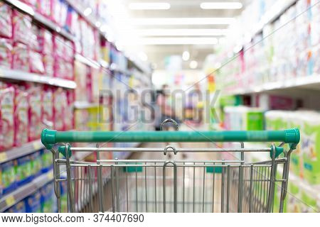 Shopping cart in supermarket, Abstract blurred photo in shopping malls, Cart in the market concept.