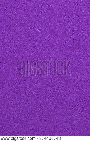 The Surface Of Dark Violet Cardboard. Rough Paper Texture With Cellulose Fibers. Saturated Color. Pu