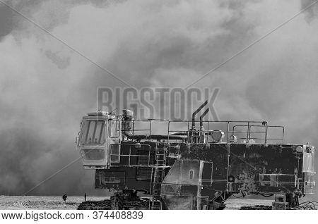 Dust Storm After Detonator Blast Near The Construction Machines
