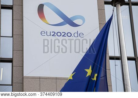 Brussels, Belgium - July 1st, 2020: European Flags Blowing In Front Of The Seat Of The Council Of Th
