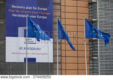 Brussels, Belgium -july 1st, 2020: European Flags In The Wind In Front Of The \