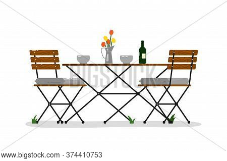 Garden Table And Chairs. Isolated Outside Wood And Metal Chair Seats, Flower Vase, Wine Bottle On Ta