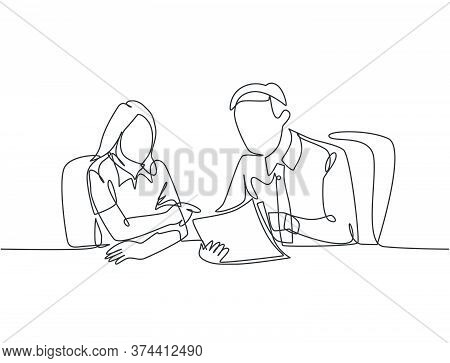 One Single Line Drawing Of Two Young Male And Female Worker Holding A Paper And Discussing About Wor