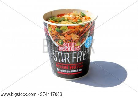 Lake Forest, CA / USA - July 1, 2020: Teriyaki Beef Noodle Soup with Vegetables. Beef Noodle Soup in its paper container. Isolated on white. Room for text. Editorial Use Only.