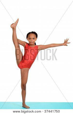 Black child doing gymnastics split