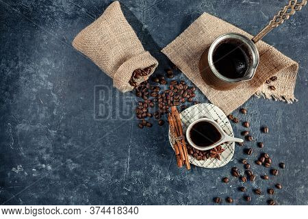 Composition With Arabica Coffee In Light Cups, Unusual Shape, On A Dark Graphite Background. The Con