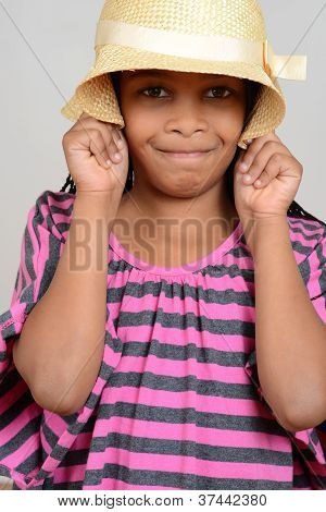 Young black child silly with hat