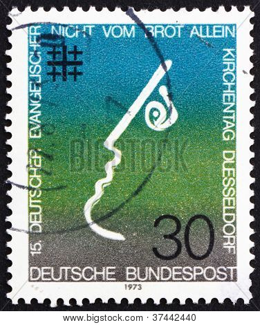 GERMANY - CIRCA 1973: a stamp printed in the Germany shows Not by Bread Alone, 15th Meeting of German Protestants, Evangelical Synod, Dusseldorf, circa 1973 poster