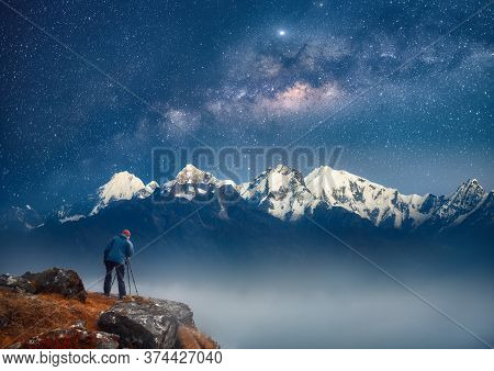 Photographer Traveler Who Take Picture Of Mountains Range Enjoying Stars Galaxy Of Over Snowy Mounta