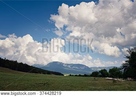 Beautiful Sky With Clouds In The Sunny And Green Hills.