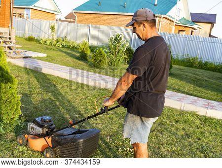 Man Mows A Lawn Mower, Summer, Infield