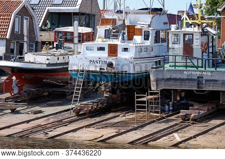 Urk, The Netherlands - June 22 2020: Three Yachts For Repair And Maintenance In The Dockyard Of Urk,