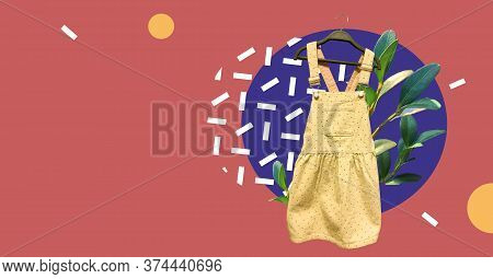 Yellow Dotted Children Corduroy Overall Dress On Hanger With Fresh Plants Isolated On Abstract Color