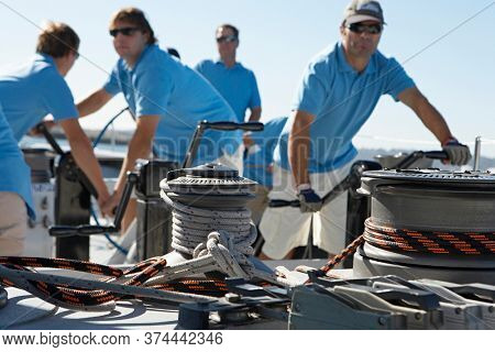 Photo of Male sailing team on yacht