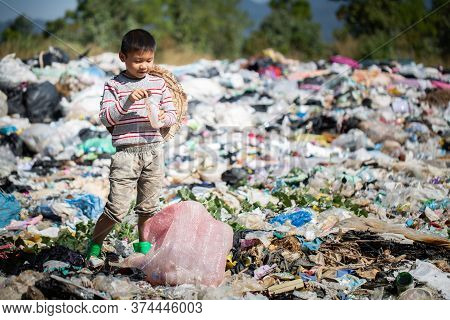 Poverty In India, A Child Collects Garbage In A Landfill Site, Concept Of Livelihood Of Poor Childre