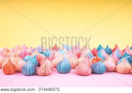 Soft Pink And Blue Color Of Mini Marshmallows Dessert Background. Concept For Holiday Party Card.