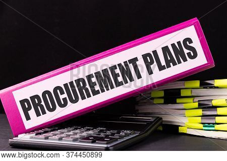 Procurement Plans Text Is Written On A Folder Lying On A Stack Of Papers On An Office Desk. Business