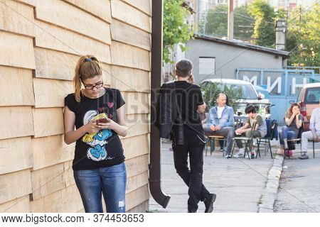 Belgrade, Serbia - May 21, 2016: Two Youngsters, Female And Male, Calling Using Their Smartphones, O