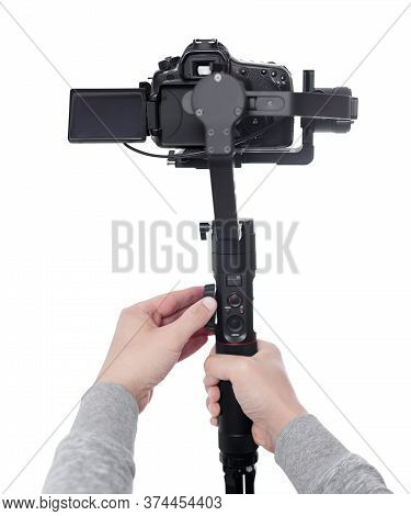 Modern Dslr Camera On 3-axis Gimbal Stabilizer In Male Videographer Hands Isolated On White Backgrou