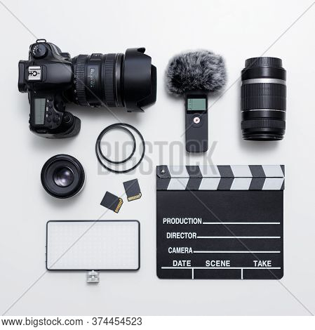 Videography And Photography Equipment - Top View Of Modern Dslr Camera, Lenses, Filters, Microphone