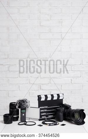 Videography Concept - Modern Dslr Camera, Lenses, Microphone, Led Light, Memory Cards, Clapper Board