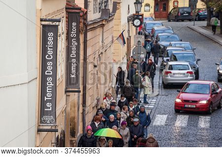 Prague, Czechia - November 2, 2019:  Crowd Waiting In Front Of A Le Temps Des Cerises Logo On Their