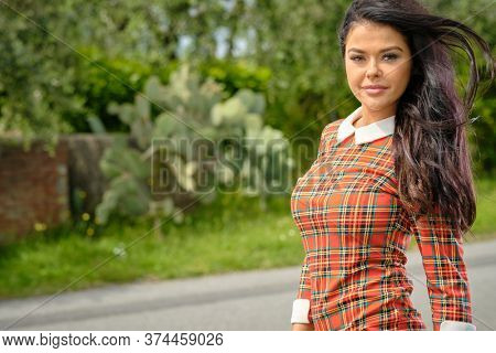 Vintage Fashionably dressed woman on the streets of Italian country