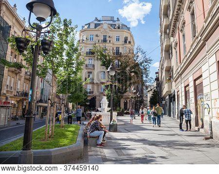 Belgrade, Serbia - June 23, 2018: People Walking And Sitting, Relaxing, On The Pedestrian Street Of