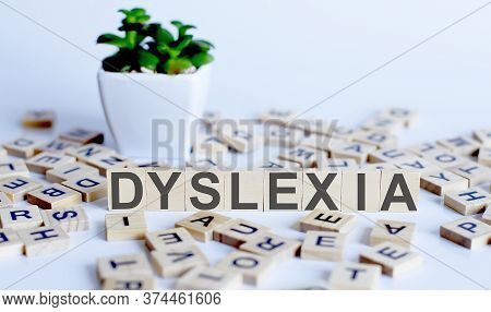 Dyslexia Word Formed With Wooden Blocks. Reading Difficulties Concept.