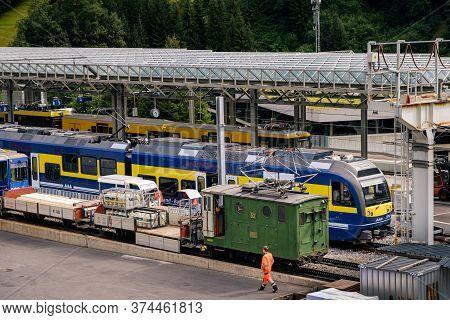 Lauterbrunnen, Berner Oberland, Switzerland - July 29 2019 : Freight And Passenger Trains In The Lau