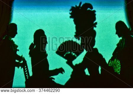 Puppet Silhouettes With Old Vintage Puppet Theater.