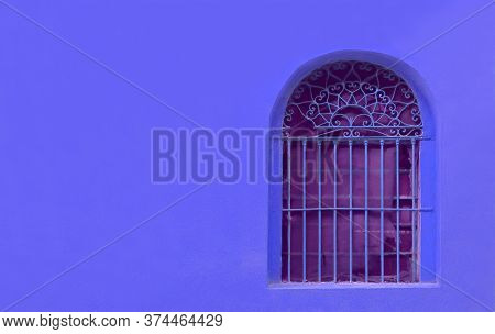 Wrought Iron Window On Royal Blue Concrete Wall With Copy Space
