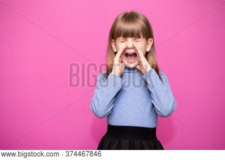 Beautiful Little Girl Reacting Emotionally Grabbing Head With Both Hands. Delighted And Shocked Kid