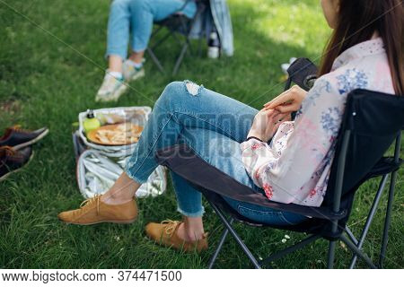 Social Distancing. Small Group Of Young Woman Enjoying Conversation At Picnic With Social Distance I