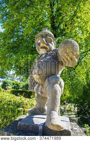Salzburg, Austria, 09,03,2011. Statue Of A Dwarf From The Garden Of The Dwarfs Of Mirabel Park. Dwar